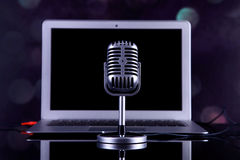 Professional silver microphone. On a black glossy background royalty free stock image