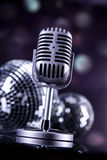 Professional silver microphone. On a black glossy background royalty free stock photos