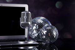 Professional silver microphone. On a black glossy background stock photo