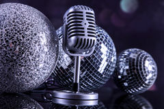Professional silver microphone. On a black glossy background royalty free stock photo