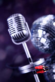 Professional silver microphone. On a black glossy background stock photos
