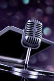 Professional silver microphone. On a black glossy background royalty free stock images