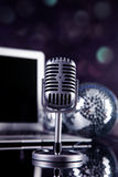 Professional silver microphone. On a black glossy background stock images