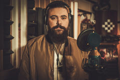 Professional singer recording song in boutique recording studio Royalty Free Stock Photography