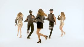 Professional singers and dancers show the musical number. They are moving synchronously. HD stock video