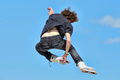 A professional skater at the Inline skating jumps competition Royalty Free Stock Image