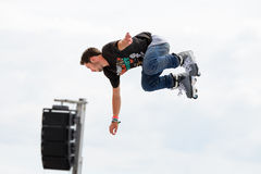 A professional skater at the Inline skating jumps competition at LKXA Extreme Sports Barcelona Games Royalty Free Stock Photography