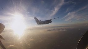 Professional skydivers fly in airplane. Sunset. Porthole. Prepare jump. Extreme. Sport stock video footage