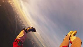 Professional skydivers fly in cloudy sky on sunset. Extreme sport. Uniform. Flight stock video footage