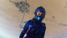 Professional skydivers jump from airplane in blue sky, holding hands. Sunny. Extreme sport stock video footage