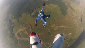 Professional skydivers in uniform falling in sky. Extreme sport. Hold balance. Speed. Adrenaline stock footage