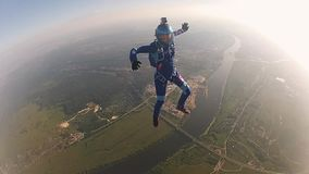 Professional skydivers in uniform falling in sky. Extreme sport. Holding balance. Speed. Adrenaline stock video