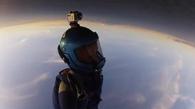 Professional skydivers in uniform free falling in sky. Open parachute. Sunset. Adrenaline stock video footage