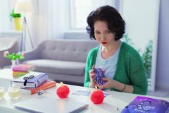 Professional smart fortune teller holding tarot cards. Prediction of destiny. Professional smart fortune teller holding tarot cards while having an online stock photos