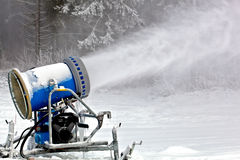 Professional snow cannon making snowflakes Royalty Free Stock Photography