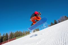 Professional snowboarder riding in the mountains Royalty Free Stock Photos