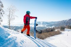 Snowboarder exploring snowy mountains Royalty Free Stock Photography