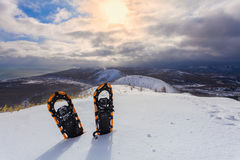 Professional snowshoes in the snow on the winter mountains and sky with clouds background. Snowshoeing Royalty Free Stock Photography