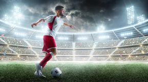 Professional soccer player in action. Ball in action on the night soccer stadium with fans and flags. 3d football stock images
