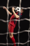 Professional Soccer Player Controlling Ball In Studio Stock Photo
