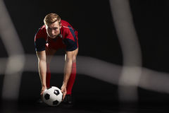 Professional Soccer Player Placing Ball For Penalty Kick Stock Images