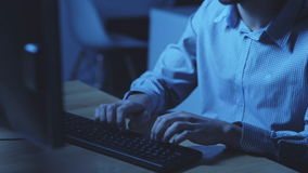 Professional software developer hicking. Find out IP adress. Professional software developer sitting at the table and hacking while working at night stock footage