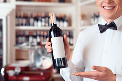 Professional sommelier holding wine bottle Royalty Free Stock Images