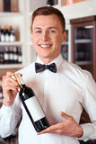 Professional sommelier holding wine bottle Stock Photography