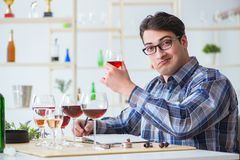 The professional sommelier tasting red wine Stock Photo