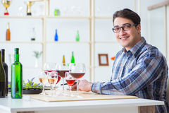 The professional sommelier tasting red wine. Professional sommelier tasting red wine Royalty Free Stock Image