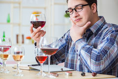 The professional sommelier tasting red wine. Professional sommelier tasting red wine Royalty Free Stock Photo
