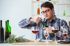 The professional sommelier tasting red wine Stock Image