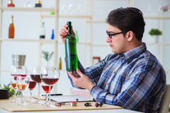 The professional sommelier tasting red wine Royalty Free Stock Photo