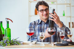 The professional sommelier tasting red wine Stock Images