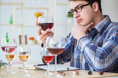 The professional sommelier tasting red wine Stock Photos