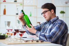The professional sommelier tasting red wine. Professional sommelier tasting red wine Royalty Free Stock Photos