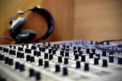 Professional soud mixer with headphones in background Royalty Free Stock Image
