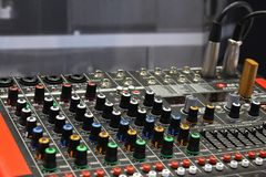 Professional sound equipment. Model mixing console. Digital music royalty free stock image
