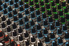 Professional Sound Mixer. Close-up view of colorful control buttons for sound adjusting in a recording studio. Sound equipment. Music record service royalty free stock photography