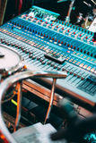 Professional Sound mixing console with many knobs Stock Image