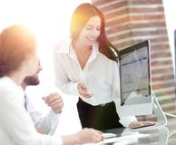 Professional specialists of the company discussing financial sch. Edules at the working table. accounting Stock Photos