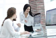 Professional specialists of the company discussing financial schedules Royalty Free Stock Image