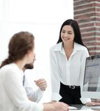 Professional specialists of the company discussing financial schedules Stock Images