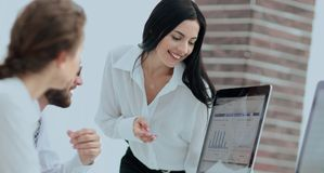Professional specialists of the company discussing financial schedules. At the working table. accounting Stock Image