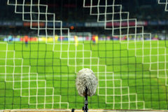 Professional sport microphone on a soccer field Royalty Free Stock Photos