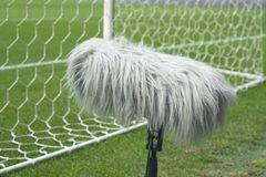 f7553b0f9 Professional sport microphone on a soccer field behind. The net royalty  free stock photo