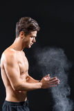 Professional sportsman applying powder on arms Stock Photography