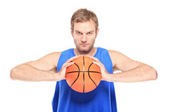 Professional sportsman holding a basketball Royalty Free Stock Images