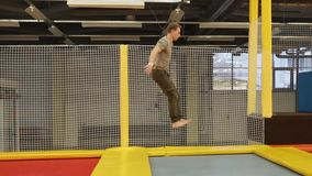 Professional sportsman on a trampoline stock footage