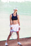 Professional Sportswoman With Tennis Racquet at the Tennis Cour Royalty Free Stock Photos
